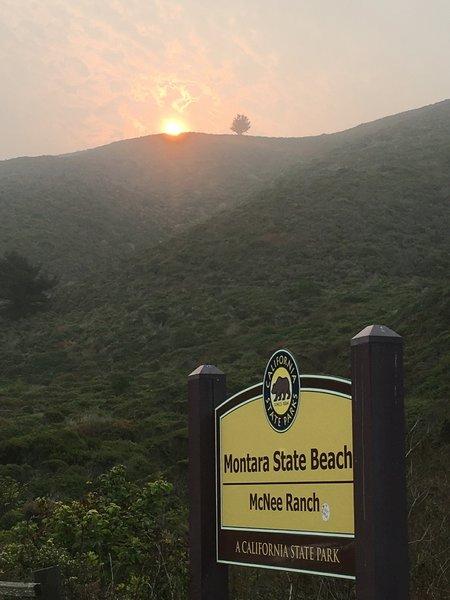8 am sunrise at trailhead in smokey air.