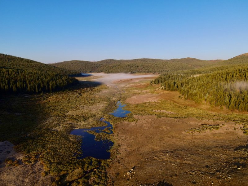 Drone footage of the morning fog over the marshland about 7 miles in. Trail can be seen to the right.