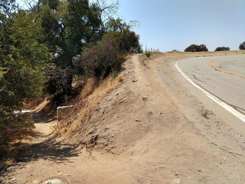 Where Colby Trail meets Glendora Mountain Road.  Note, thin shoulder where pickup possible but not parking.