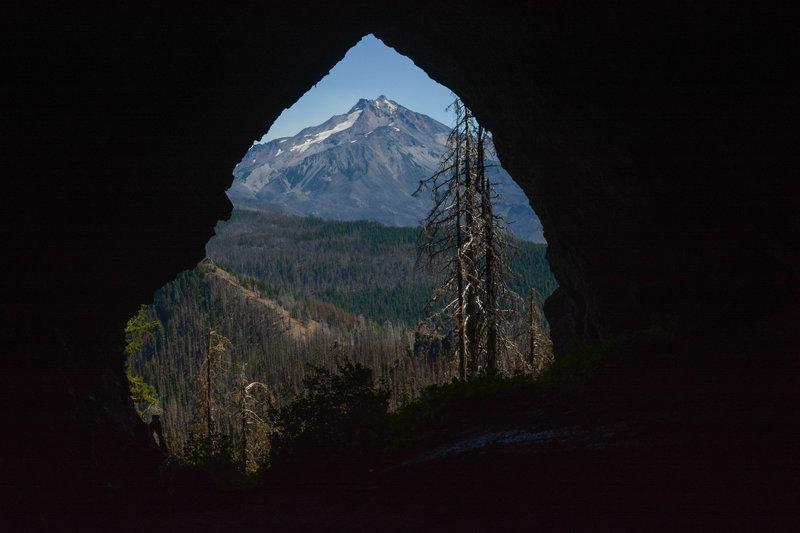 Boca Cave's entrance perfectly frames Mount Jefferson.