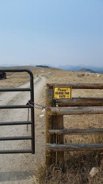 Livestock gate. Lake Angeline Cirque barely visible on horizon.