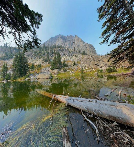 Granite peak rises above the lake.