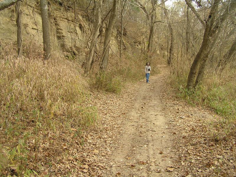 The trail runs along tall cliffs.