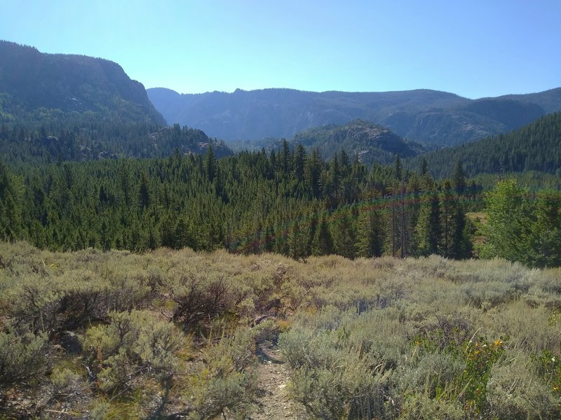 The views start to open up almost immediately as one begins climbing on Crows Nest Lookout Trail. Creeks of the Pine Creek drainage are in the deep valley beyond the nearby ridges.