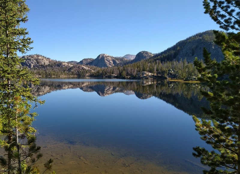 Trapper Lake on a still September morning, as seen from the lake's south end on Summit Lake Trail.