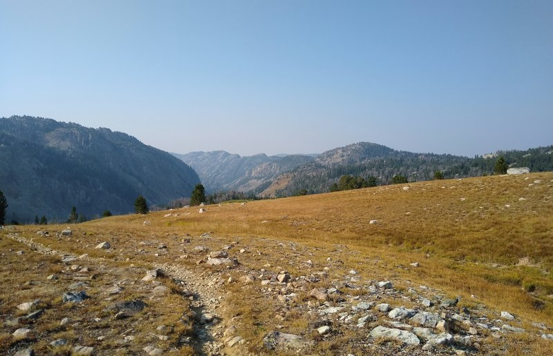 The valley ahead is the start of the Pine Creek drainage, high up here near Summit Lake. Pine Creek and its tributaries eventually flow into Fremont Lake, and on to Pinedale. Looking south from the CDT near Summit Lake on a gorgeous September morning.