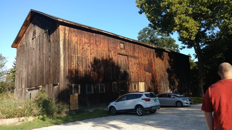 Barn at the Stanford House. Parking and trailhead is behind the barn.