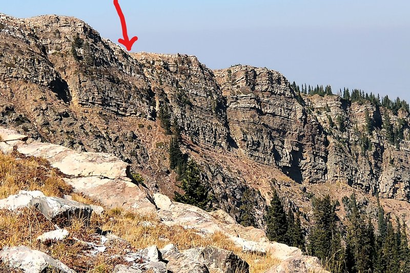 The arrow shows the beginning of the decent route on the New York Lake Trail, taken from the bottom of the headwall.