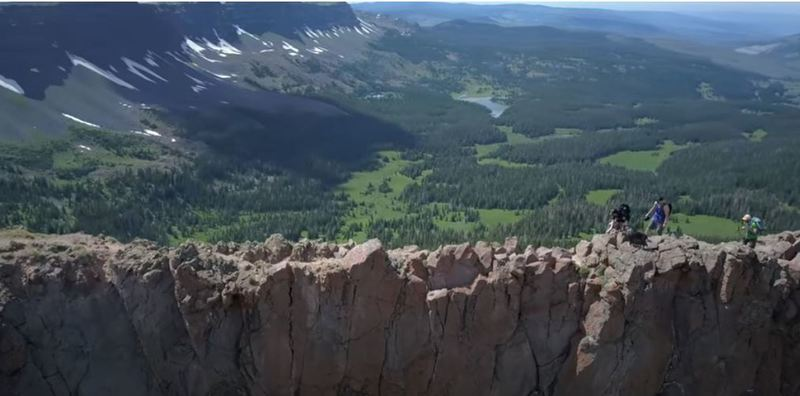 This was taken by a drone and shows the narrow trail with steep drops on both sides