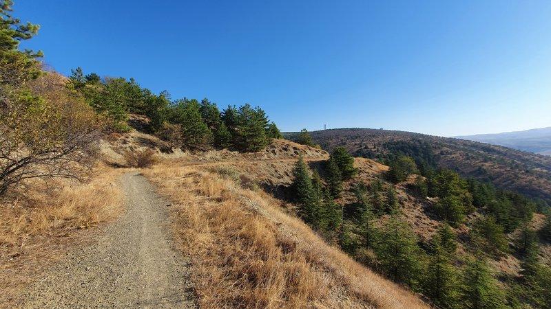 Looking back at the trail while climbing Üçgenzi Patikası (Trail).