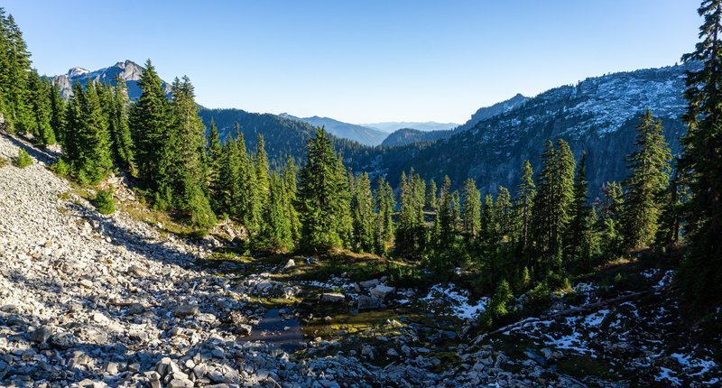 A tarn below Gem Lake, looking out towards Snoqualmie Pass.