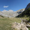 Panoramic view Circo del Soaso (Soaso cirque) with the trail at the left and Rio Arazas at the right