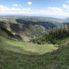70 degree panorama from the Mt Nebo bench trail with Hop Creek Ridge center left and Salt Creek Peak at the far right