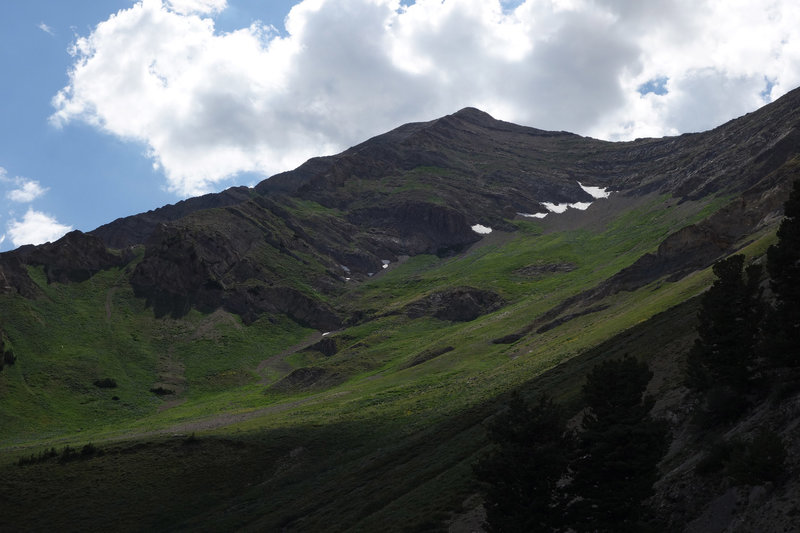 A verdant Mt. Nebo with patches of snow left on it in late July.