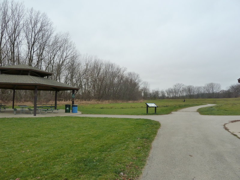 Shelter #2 with open prairie and interpretive sign.