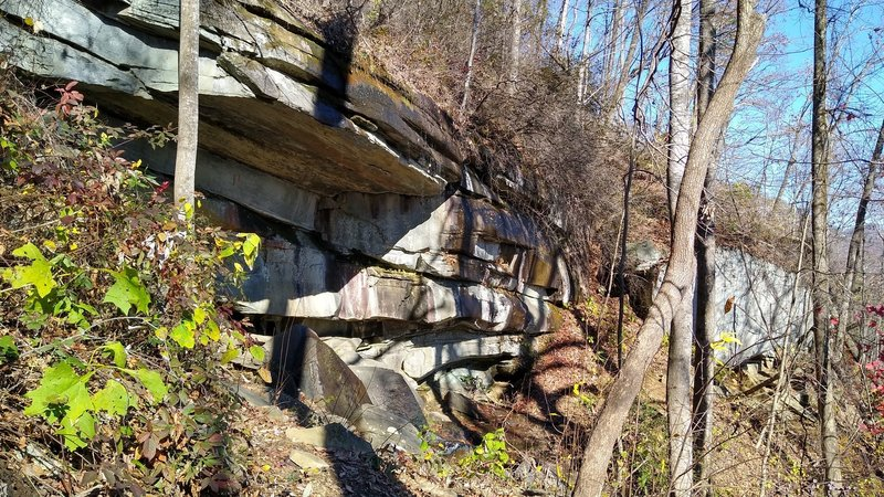 Trail passing under rocky outcrop. Water will be falling over top during periods of wet weather.