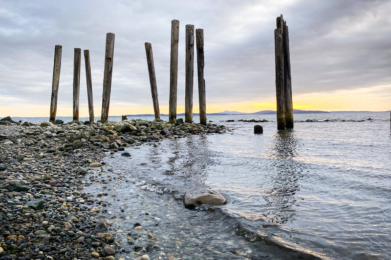 These wood pillars stand tall at the far end of Clayton Beach.