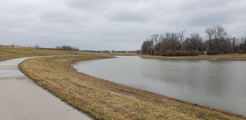 Path around the lake with drainage from the spring.