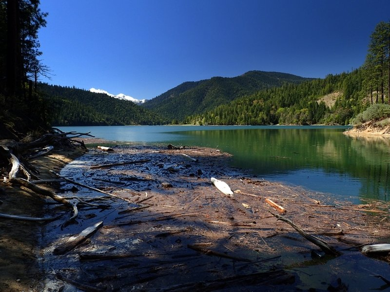 The snowy Red Buttes above a full Applegate Lake,