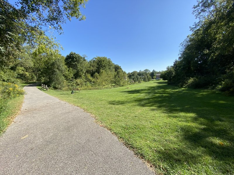 Paved trail through Owens Street Park.