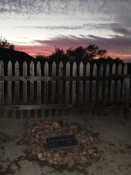 Anton Knechtel (1823-1903) gravesite at sunset, enclosed by a new wood picket fence.