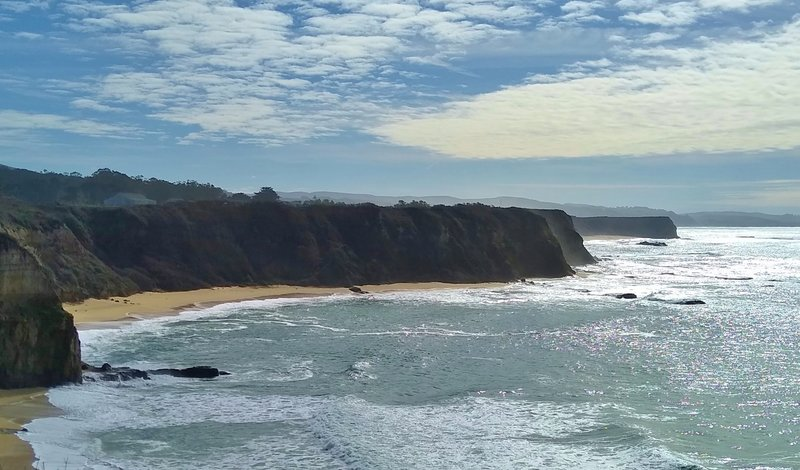 Cliffs silhouetted, and ocean shimmering in the afternoon, to the south of Cowell-Purisima Trail.