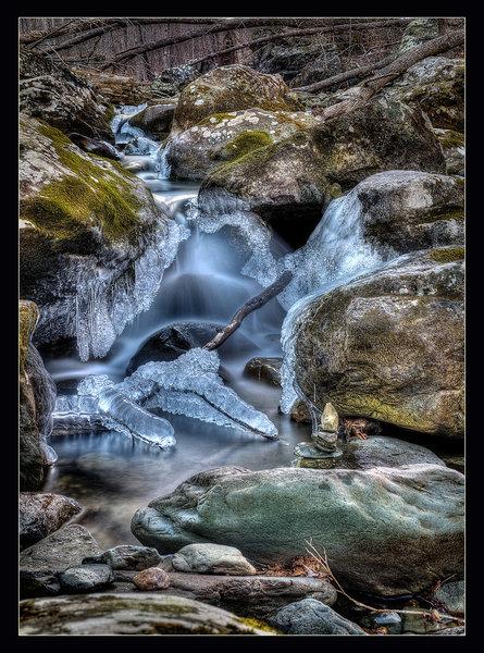 Frozen waterfalls and a rock stack at Rose River, VA.