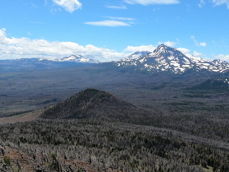 Two of the 3 Sisters and Broken Top looking south from Black Crater summit.
