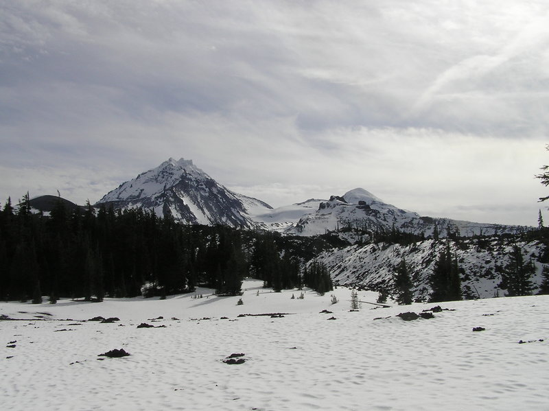 Looking southeast from trail near 4-in-1 Cone after fall snow. Collier Crater, North Sister and Little Brother (L-R).