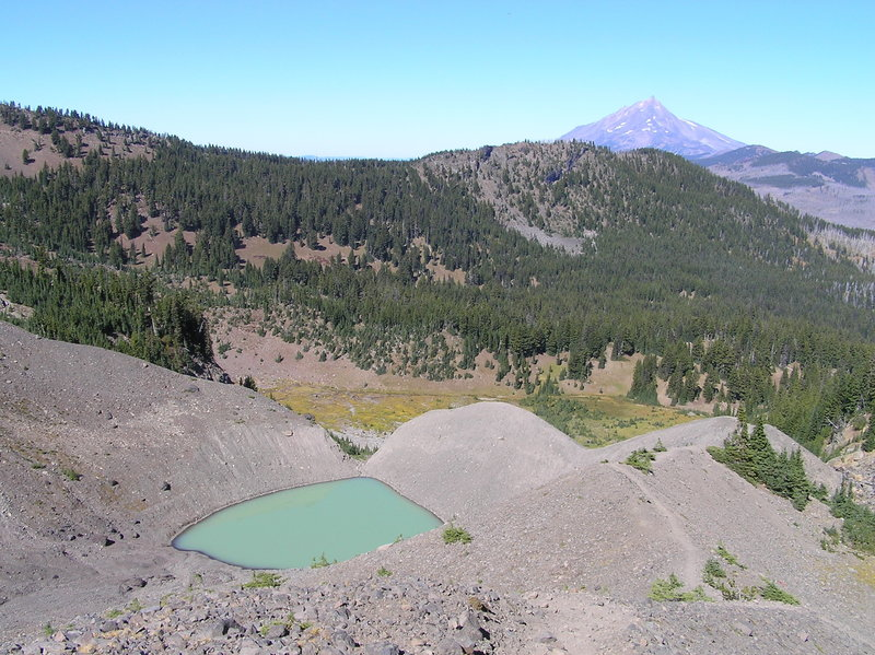 View north from trail to saddle showing tarn, Upper Canyon Meadow and Mt. Jefferson.