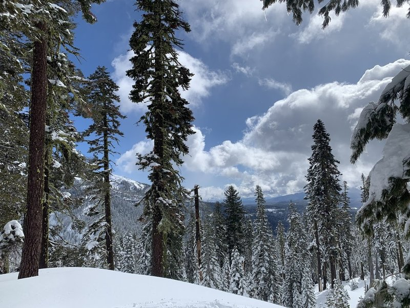 A breathtaking overlook of the peaceful, pristine winter landscape of Lassen Park on a gorgeous day.