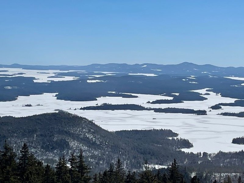 Summit in late Feb looking towards Squam, Winni is further out, Belknap Range in upper right