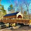 The newly replaced covered bridge over Eightmile River at sunset.