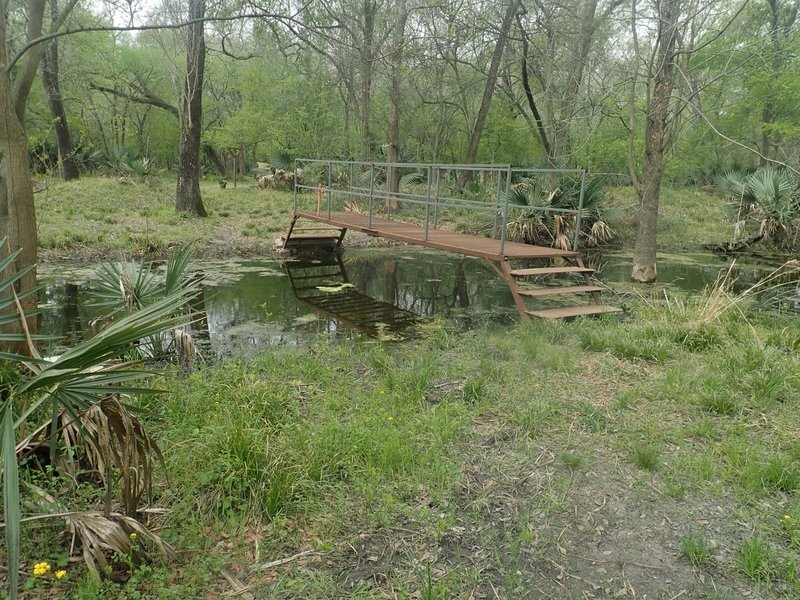 There is a bridge crossing over Turkey Creek south of the Archery area. The GPS coordinates here are 29.82025 -95.58697.