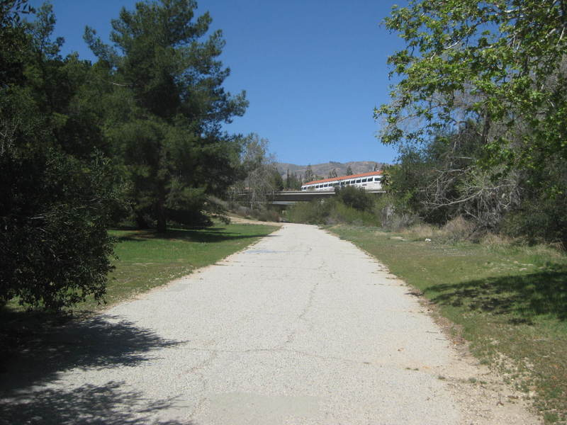 Looking north along the trail, approaching the freeway.