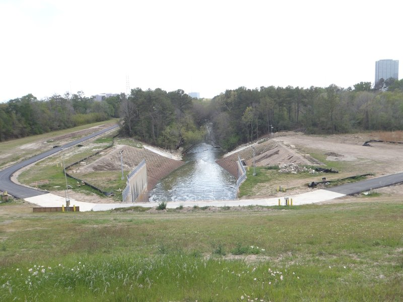 Standing on top of the dike, where the water passes through, looking south at the spillway.