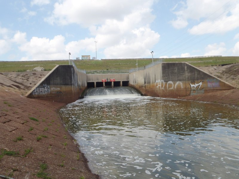 The spillway coming through the dike into Langham Creek channel, from the south side looking north.