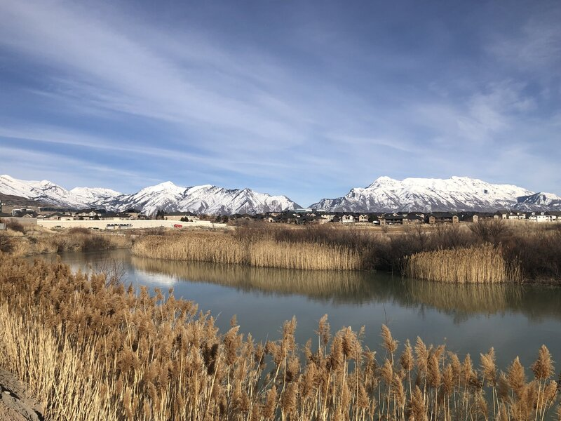 Snowcapped Wasatch mountains viewed from the Jordan River trail near Thanksgiving Point.