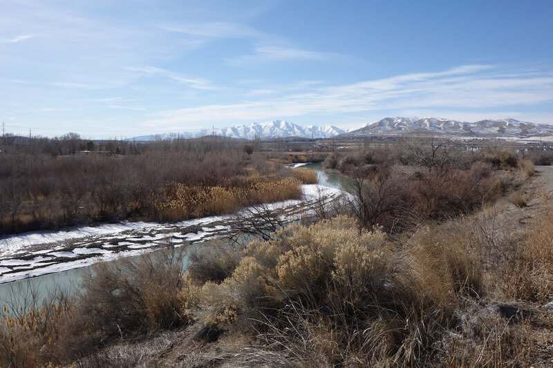 The Jordan River and the distant Oquirrh Range with snowy Flat Top Mountain in the background (center) seen on a very clear pandemic day. Latimer Point is closer, center right.