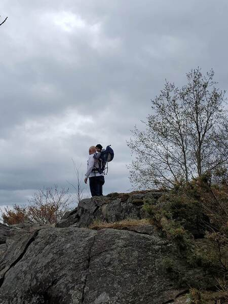 Hikers on the Canadian Shield lookout point.