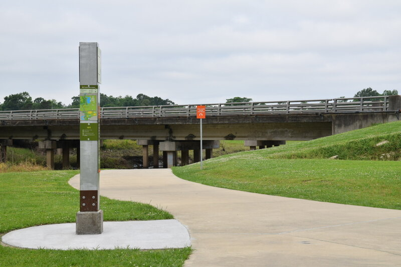 Trailhead marker near the bridge