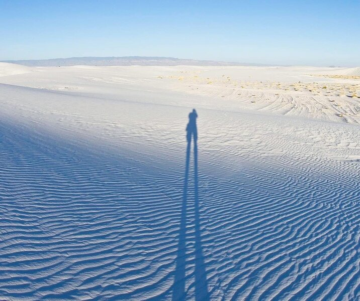Long shadows and white sands ripples.