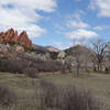 Two hikers on the Ute trail, framed by the Gateway Rocks at the Garden of the Gods.