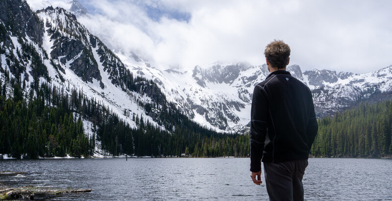 A hiker looking out at Stuart Lake.