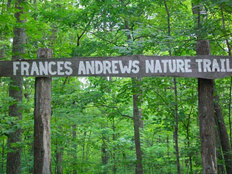 Trail sign welcomes people to start on the Frances Andrews trail.