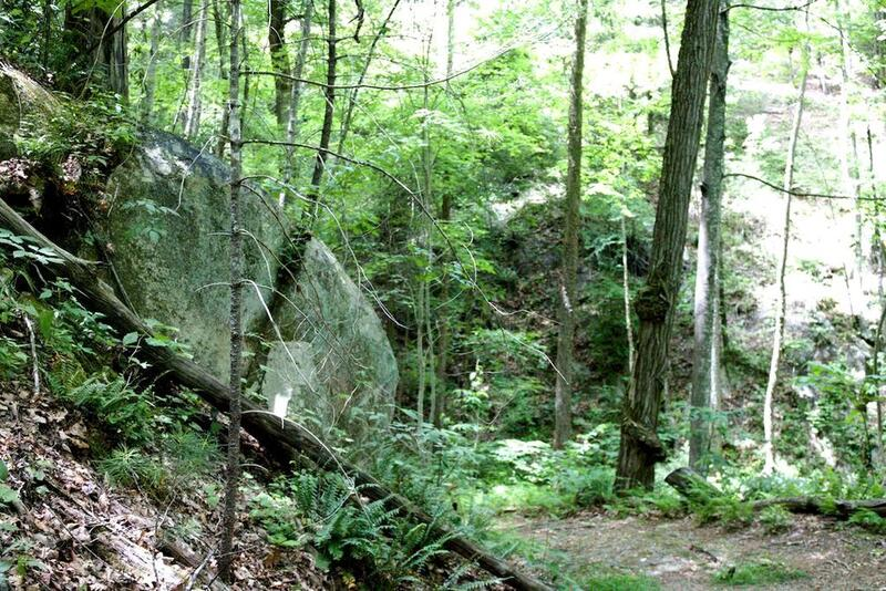 Large stone out-croppings can be seen going up along the side of Loose Mountain.