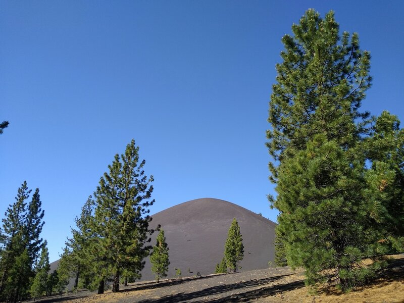 Cinder Cone comes into view when hiking south from the Butte Lake trailhead on Butte Lake to Snag Lake Trail (West).