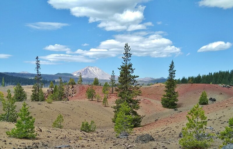 Hiking through the Painted Dunes with Lassen Peak in the distance.