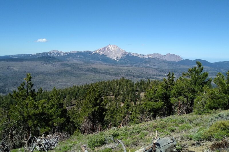 Looking southwest from the top of Prospect Peak: Lassen Peak (center), Chaos Crags (right center), and probably Mt. Conrad and Brokeoff Mountain (left center) in the far distance.