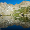 Morning reflection on Tower Lake. Trail to Tower Pass runs just below the trees on the left
